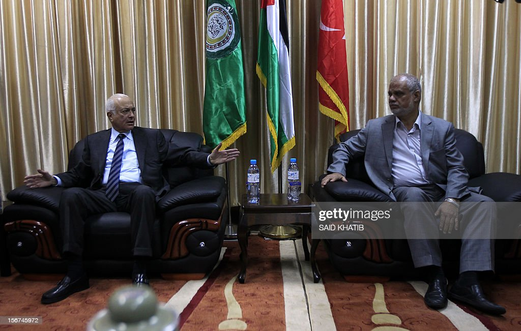 Arab League General Secretary Nabil al-Arabi (L) meets with a Hamas official in charge of prisoner affairs, Atallah Abu Sibah, upon his arrival in the southern Gaza Strip town of Rafah through the border crossing between Egypt and the Palestinian enclave on November 20, 2012. A top delegation of Arab ministers led by al-Arabi began a solidarity mission in Gaza as an Israeli air offensive entered its seventh day.
