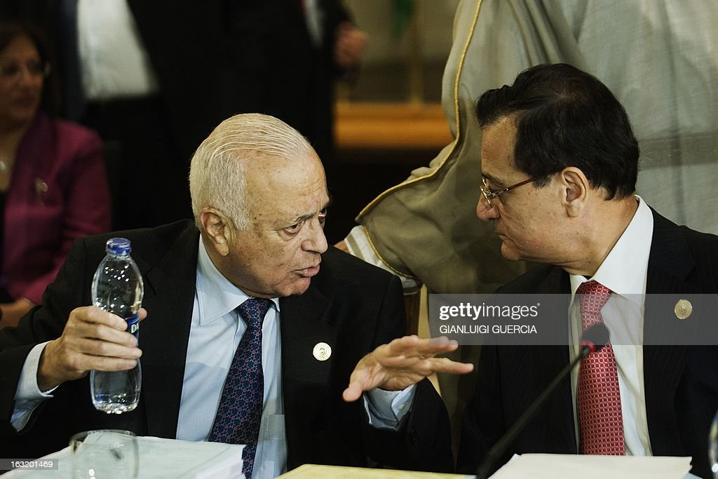 Arab League Secretary General Nabil al-Arabi (L) and Lebanese Foreign Affairs Minister Adnan Mansur (R) talk during the opening session of the Arab foreign minister meeting in Cairo on March 6, 2013. Lebanon's foreign minister called on Arab foreign ministers gathered in Cairo to let the Syrian government retake its seat at the Arab League, from which it was suspended in 2011. AFP PHOTO/GIANLUIGI GUERCIA