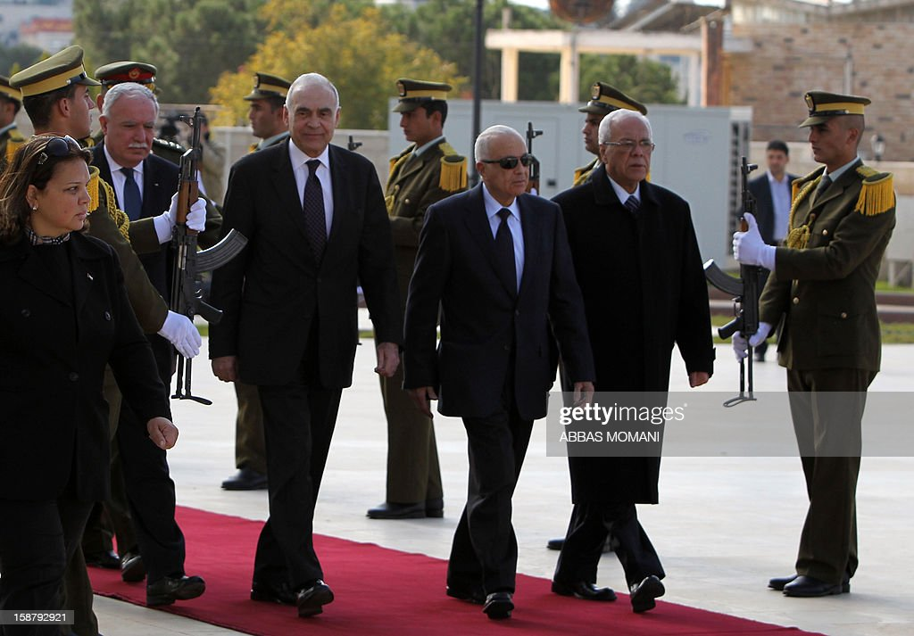 Arab League Secretary General Nabil al-Arabi (2R) arrives with Egypt's foreign Minister Mohamed Kamal Amr (2L), Palestinian Foreign Minister Riyad al-Malki (L) and Palestinian presidential aid Tayeb Ahmed Rahim (R) in the West Bank city of Ramallah for a meeting with Palestinian president Mahmud Abbas on December 29, 2012.
