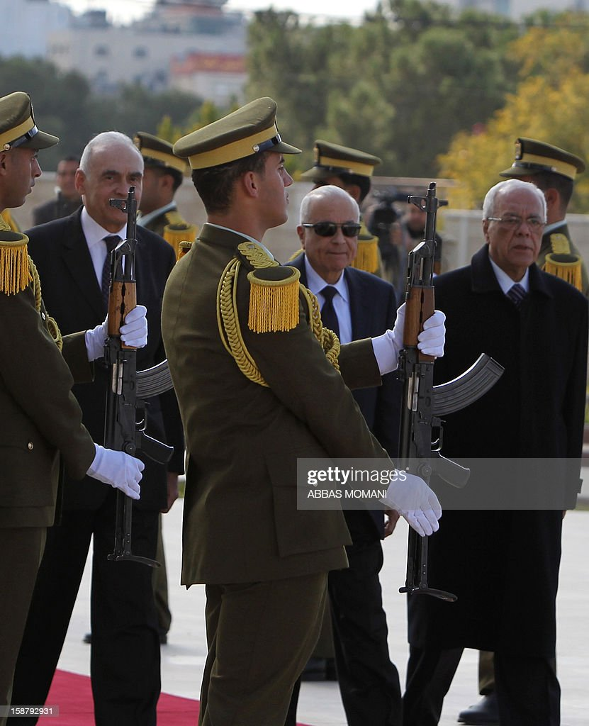 Arab League Secretary General Nabil al-Arabi (2R) is welcomed by guards standing to attention as he arrives with Egypt's foreign Minister Mohamed Kamal Amr (L) and Palestinian presidential aid Tayeb Ahmed Rahim (R) in the West Bank city of Ramallah for a meeting with Palestinian president Mahmud Abbas on December 29, 2012. AFP PHOTO/ABBAS MOMANI