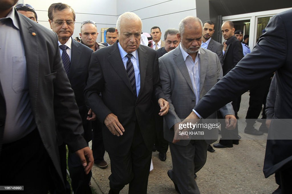 Arab League Secretary General Nabil al-Arabi (C) meets with a Hamas official in charge of prisoner affairs Atallah Abu Sibah (R) upon his arrival in the southern Gaza Strip town of Rafah through the border crossing between Egypt and the Palestinian enclave on November 20, 2012. A top delegation of Arab ministers led by al-Arabi began a solidarity mission in Gaza as an Israeli air offensive entered its seventh day.