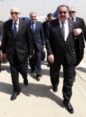 Arab League Secretary General Nabil Elaraby left walks with Iraqi Foreign Minister Hoshyar Zebari 2nd right after arriving at Baghdad International...