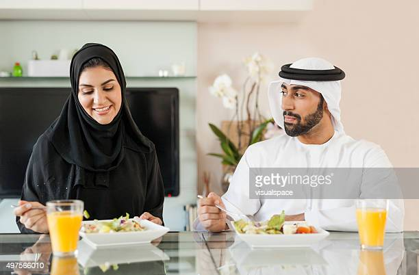 Arab Man Admiring His Beautiful Wife During Lunch Time