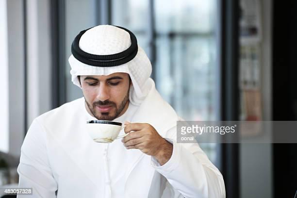 Arab man drinking coffee