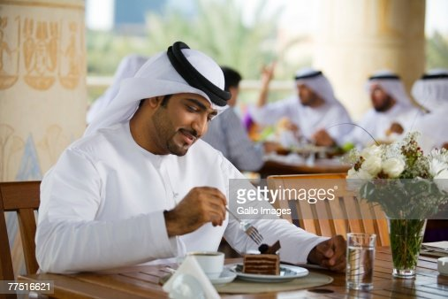 Arab Man Eating Dessert in Cafe. Dubai, United Arab Emirates