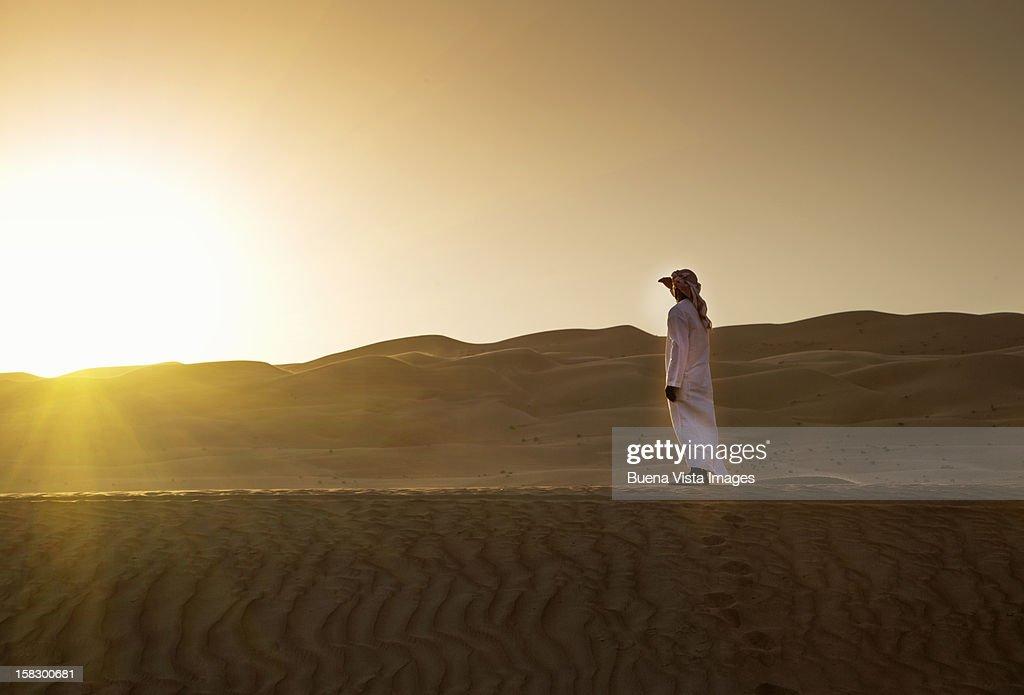 Arab man watching sun setting