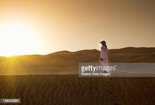Arab man watching sun setting : Stock Photo