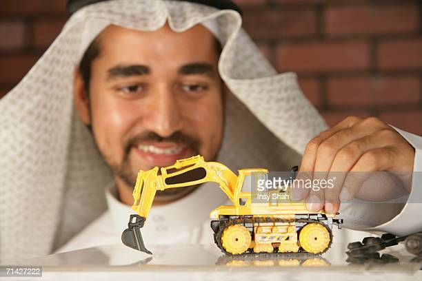 Arab Man with a toy truck