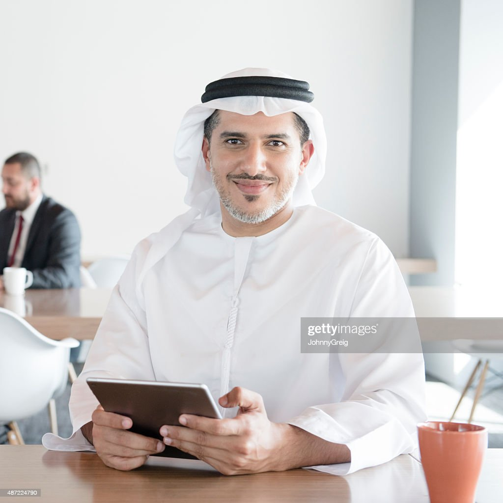 Arab man with digital tablet in office