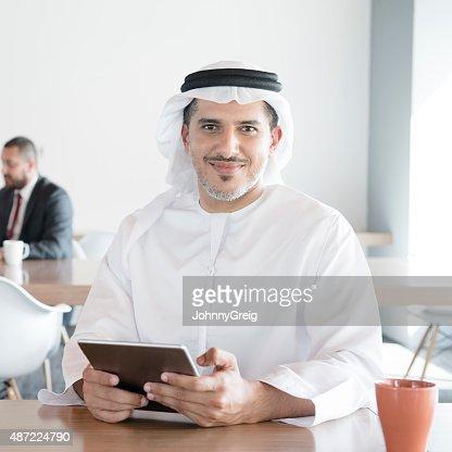 Arab man with digital tablet in office