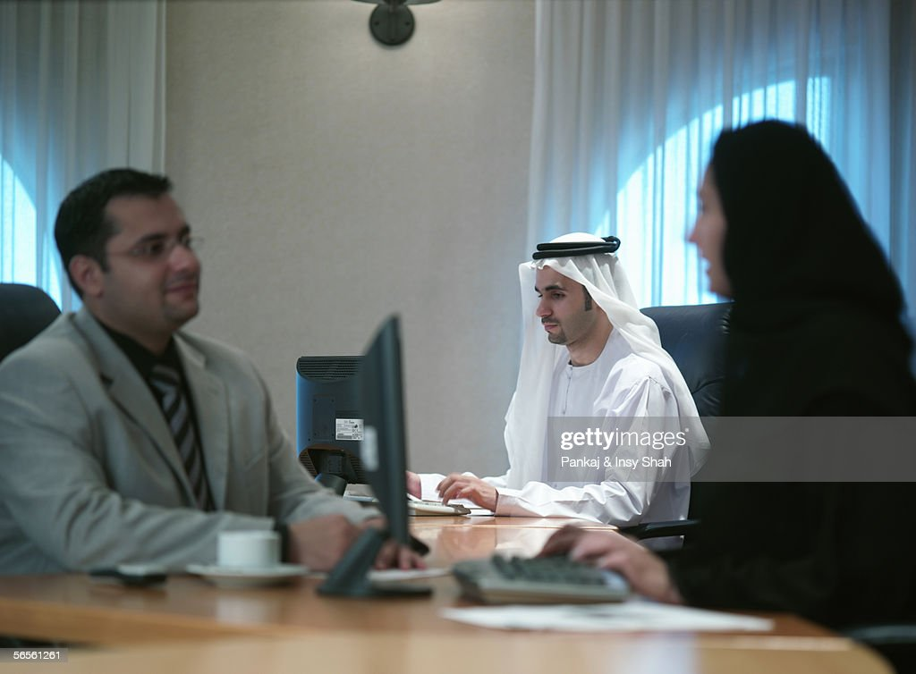 Arab men and woman in an office