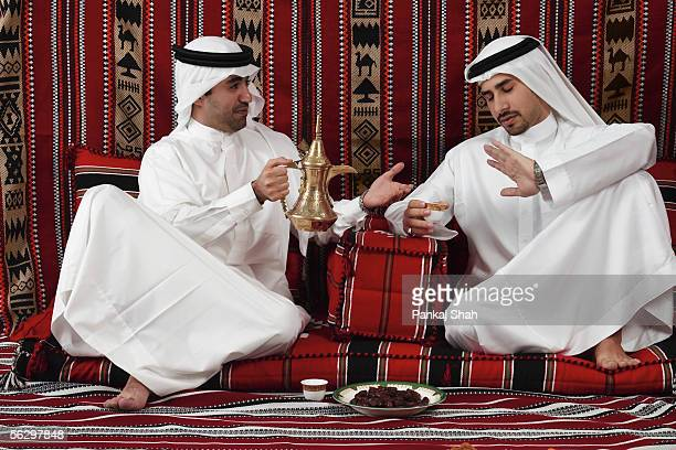 Arab men eat dates