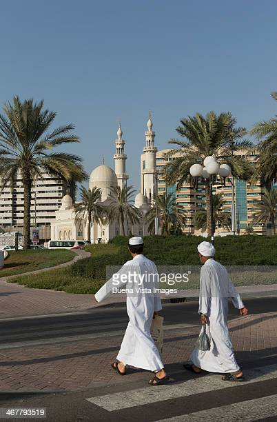 Arab men heading to a Mosque.