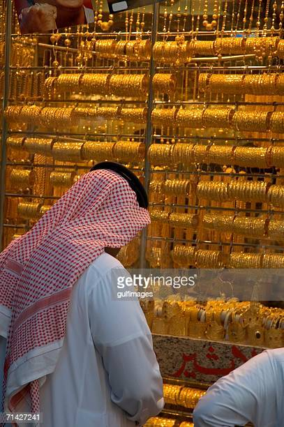 Arab Men looking at the jewelry glass display