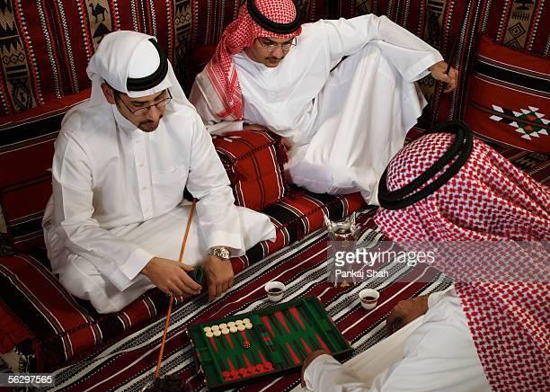 Arab men playing a board game