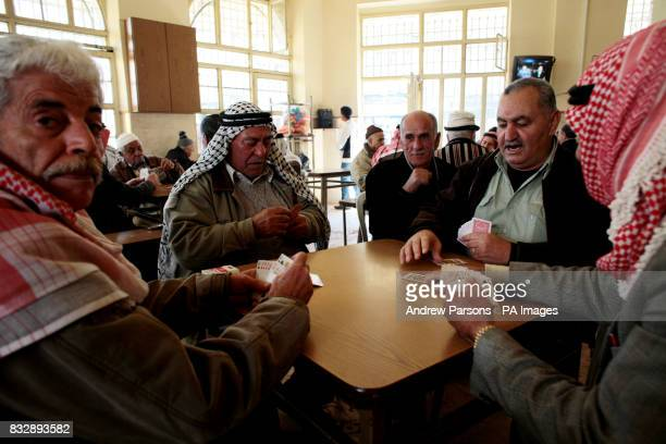 Arab men playing cards near the main square of Ramallah