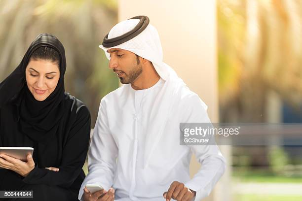 Arab Nationals with digital tablet and a smartphone