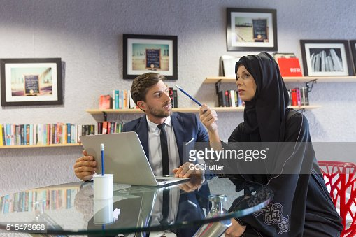 Arab Woman and an Expat in a Meeting