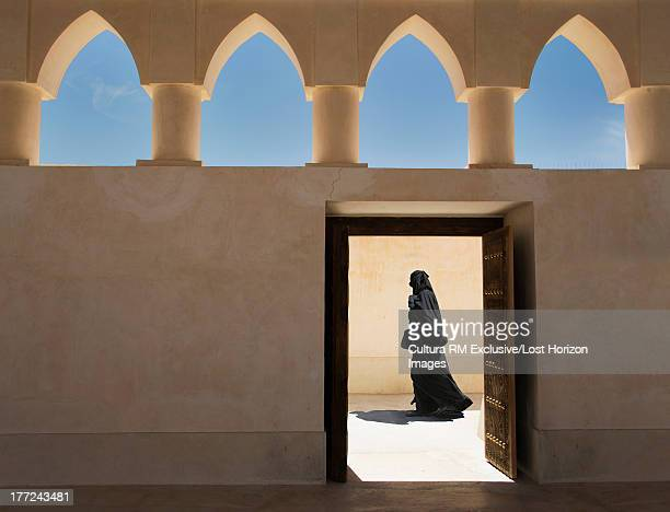 Arab woman exiting a Mosque, Doha, Qatar