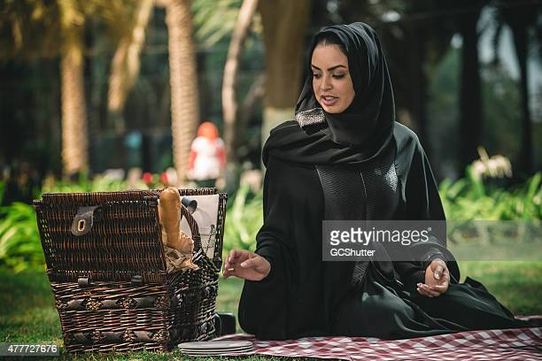 Arab woman in a park, UAE national