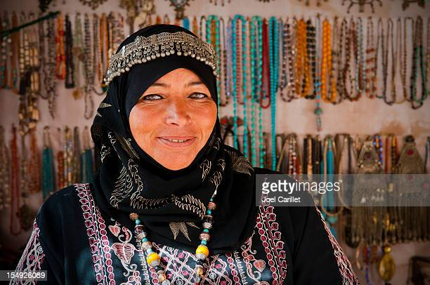 Arab woman inside her souvenir shop in Petra