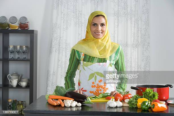 Arab woman preparing vegetables in the kitchen