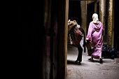 Arab woman walking in a narrow street