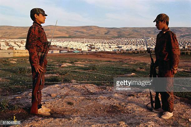 Arab youths stand with rifle and fixed bayonet during guerrilla training here at this camp on the outskirts of the Jordanian capital The guerrilla...
