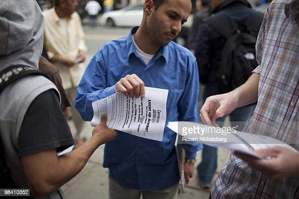 ArabAmerican men exiting a mosque following Friday prayers take fliers encouraging the arab population to fill out their 2010 census forms April 9...