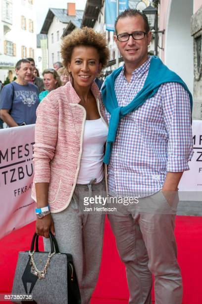 Arabella Kiesbauer and Florens Eblinger pose for a picture during the 'Inconvenient Sequel' premiere and opening night of the Kitzbuehel Film...
