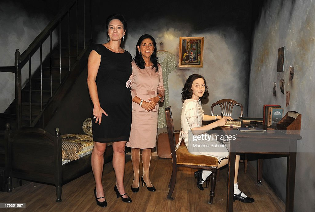 Arabella Kruschinski and Danielle Spera speak to the audience during the unveiling of new waxwork Anne Frank at Madame Tussauds Vienna on September 2, 2013 in Vienna, Austria.