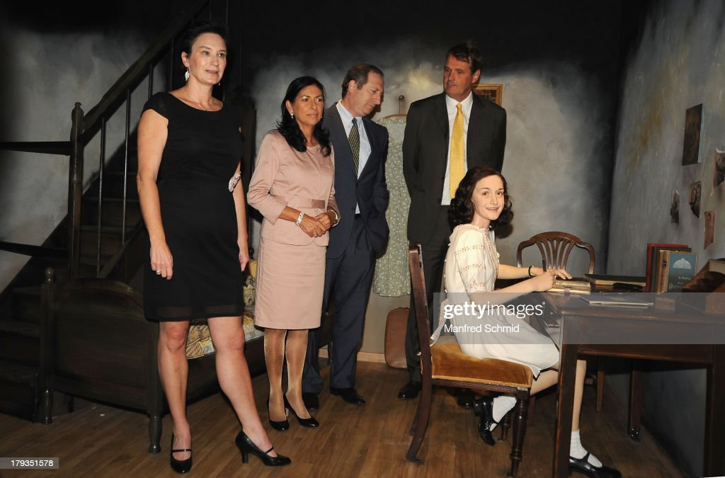 Arabella Kruschinski, Danielle Spera, Aviv Shir-On and Roelof Buffinga pose for a photograph during the unveiling of new waxwork Anne Frank at Madame Tussauds Vienna on September 2, 2013 in Vienna, Austria.