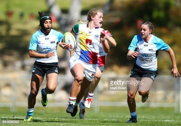 Arabella McKenzie makes a line break during the match between Macquarie University and the University of Canberra at the Womens Sevens University...