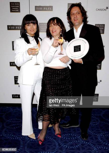 Arabella Weir presents Chef Giorgio Locatelli and wife Plaxy from Locanda Locatelli with their Italian Restaurant Of The Year Award during the Tio...