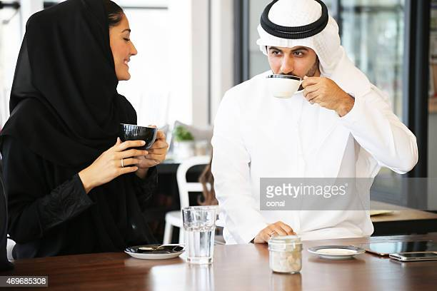 Arabian couple enjoying leisure time in a cafe