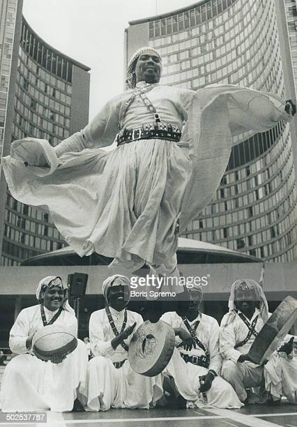 Arabian dancer Nazha Aman a member of the Saudi Arabian Folkloric Dance Troupe performs yesterday at Nathan Phillips Square