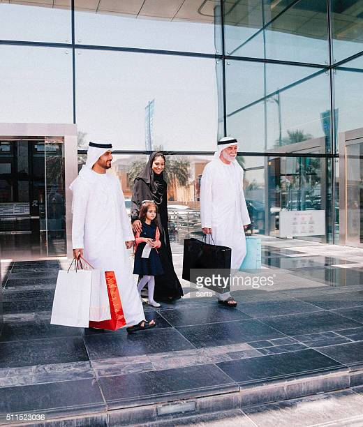 Arabian family walking after a successful shopping