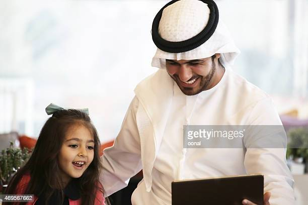 Arabian father and daughter enjoying leisure time in a cafe