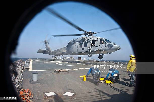 Arabian Gulf, June 26, 2012 - An MH-60S Sea Hawk helicopter takes off from the flight deck of the guided-missile destroyer USS Porter.