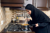 Arabian House Wife cooking in her kitchen