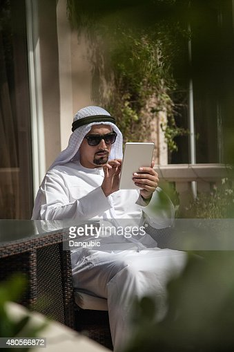 Arabian Male Using Smart Phone Out : Stock Photo