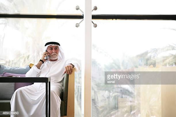 Arabian man talking on phone