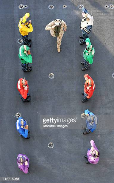 Arabian Sea, January 18, 2011 - Chief of Naval Operations passes through the rainbow sideboys aboard the aircraft carrier USS Abraham Lincoln.