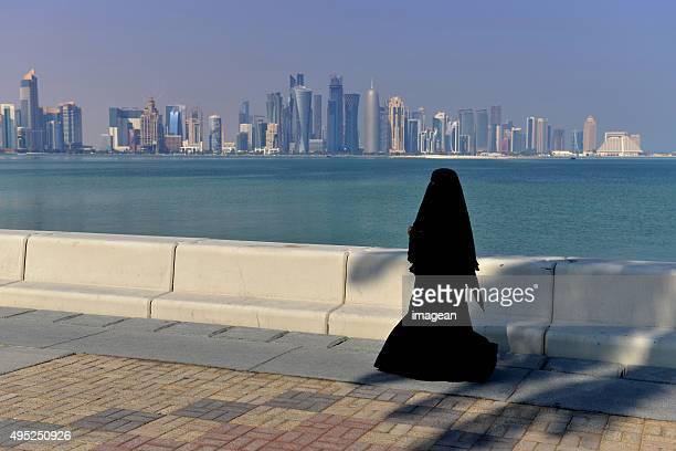 Arabian Woman strolling in sunny Doha, Qatar