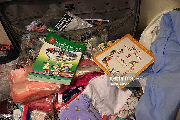 Arabic books sit in a closet inside the home of shooting suspect Syed Farook on December 4 2015 in Redlands California The San Bernardino community...