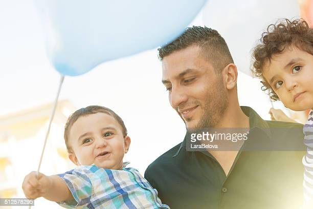 Arabic father with his little childs