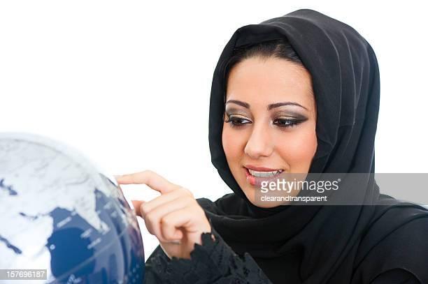 Arabic girl looking at a globe