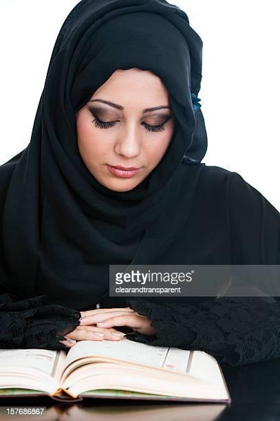 Arabic girl reading the Koran