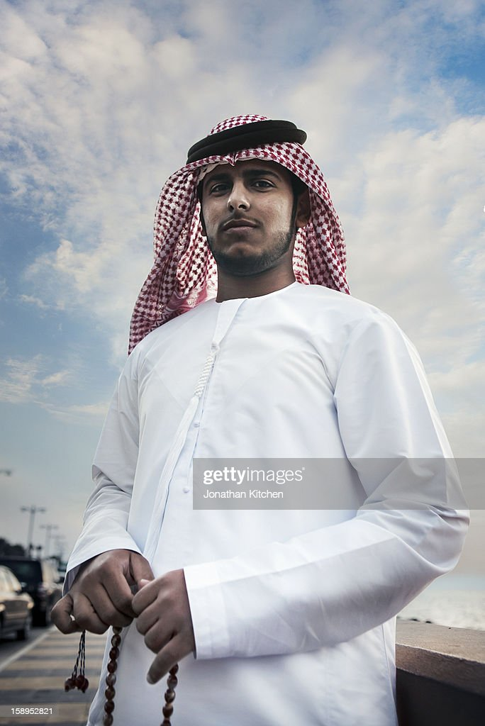 Arabic man holding prayer beads : Stock Photo