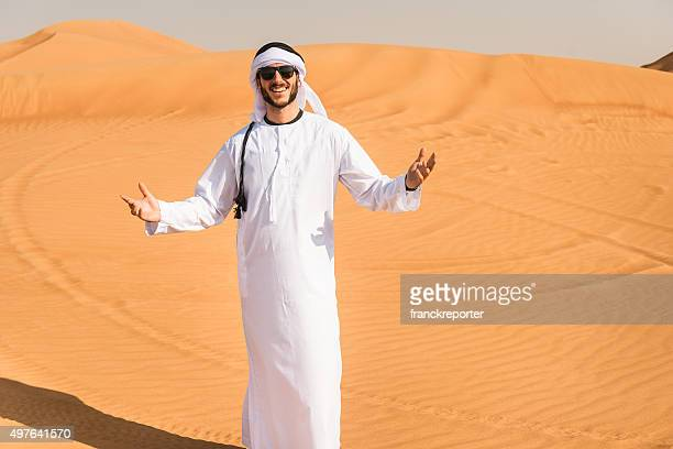 arabic man smiling on the desert